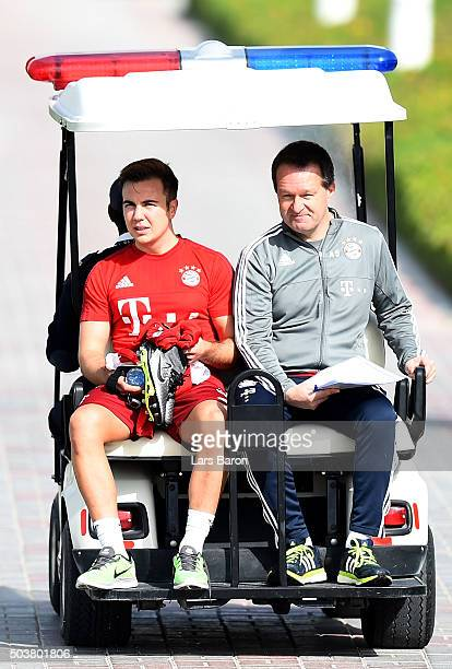Mario Goetze is seen on a golf card during a training session at day two of the Bayern Muenchen training camp at Aspire Academy on January 7 2016 in...