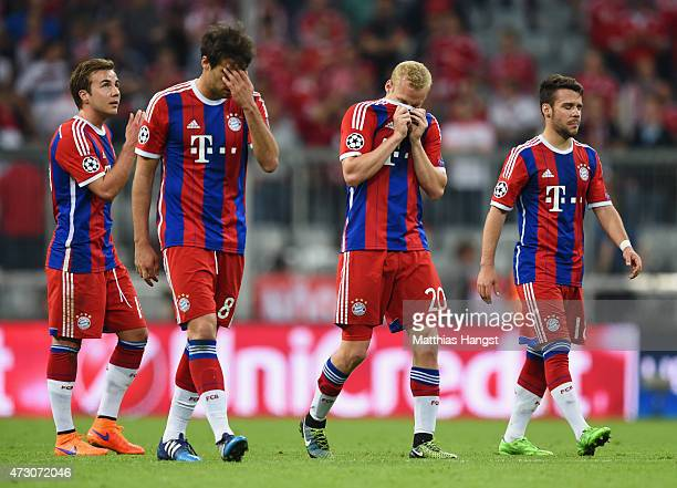 Mario Goetze Javi Martinez Sebastian Rode and Juan Bernat of Bayern Muenchen look on aafter elimination the UEFA Champions League semi final second...