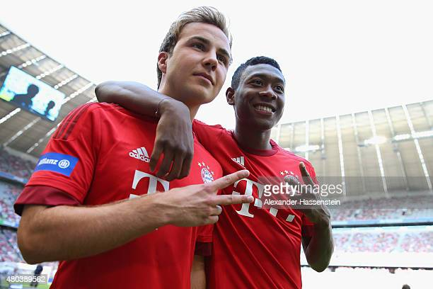 Mario Goetze jokes with David Alaba during the FC Bayern Muenchen season opening and team presentation at Allianz Arena on July 11 2015 in Munich...