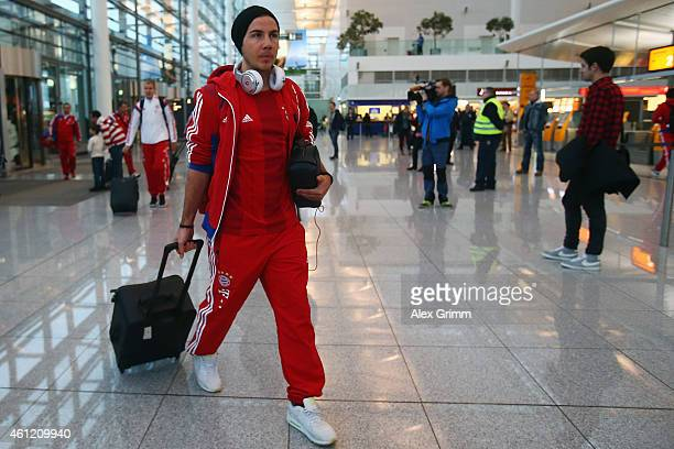 Mario Goetze of Bayern Muenchen arrives at the airport for the departure to the team's training camp in Doha Qatar on January 9 2015 in Munich Germany
