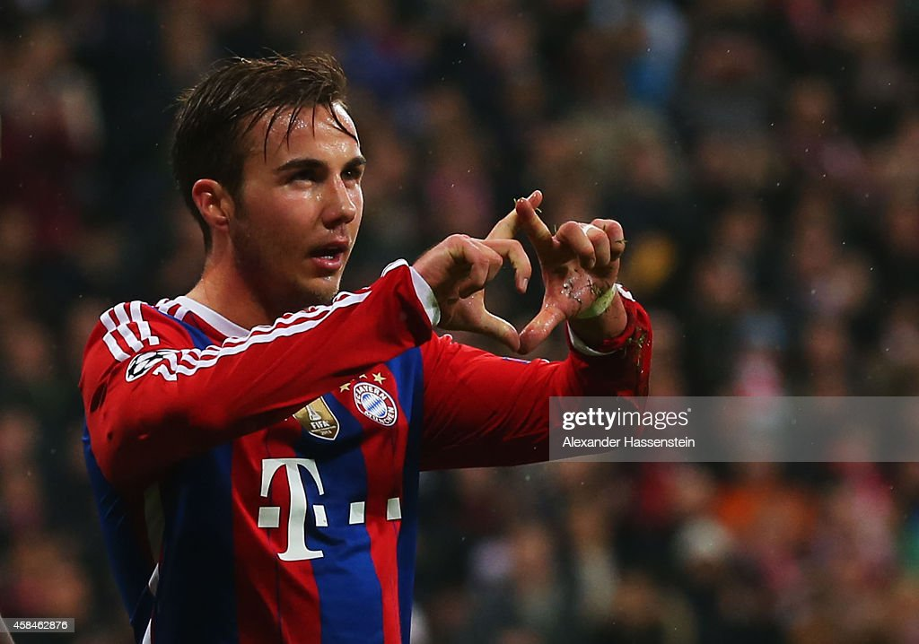 <a gi-track='captionPersonalityLinkClicked' href=/galleries/search?phrase=Mario+Goetze&family=editorial&specificpeople=4251202 ng-click='$event.stopPropagation()'>Mario Goetze</a> of Bayern Muenchen celebrates as he scores their second goal during the UEFA Champions League Group E match between FC Bayern Munchen and AS Roma at Allianz Arena on November 5, 2014 in Munich, Germany.