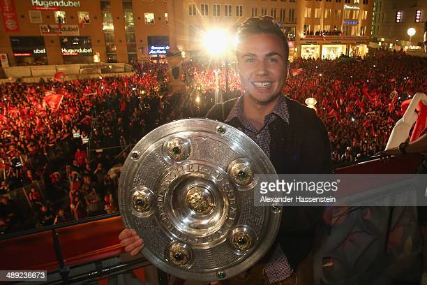 Mario Goetze of Bayern Muenchen celebrates winning the German championship title on the town hall balcony at Marienplatz on May 10 2014 in Munich...