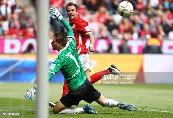 Mario Goetze of Bayern Muenchen scores his team's second goal past RonRobert Zieler of Hannover 96 during the Bundesliga match between FC Bayern...