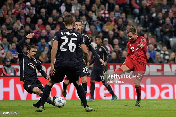 Mario Goetze of Bayern Muenchen scores his team's third goal during the UEFA Champions League Group F match between FC Bayern Munchen and GNK Dinamo...
