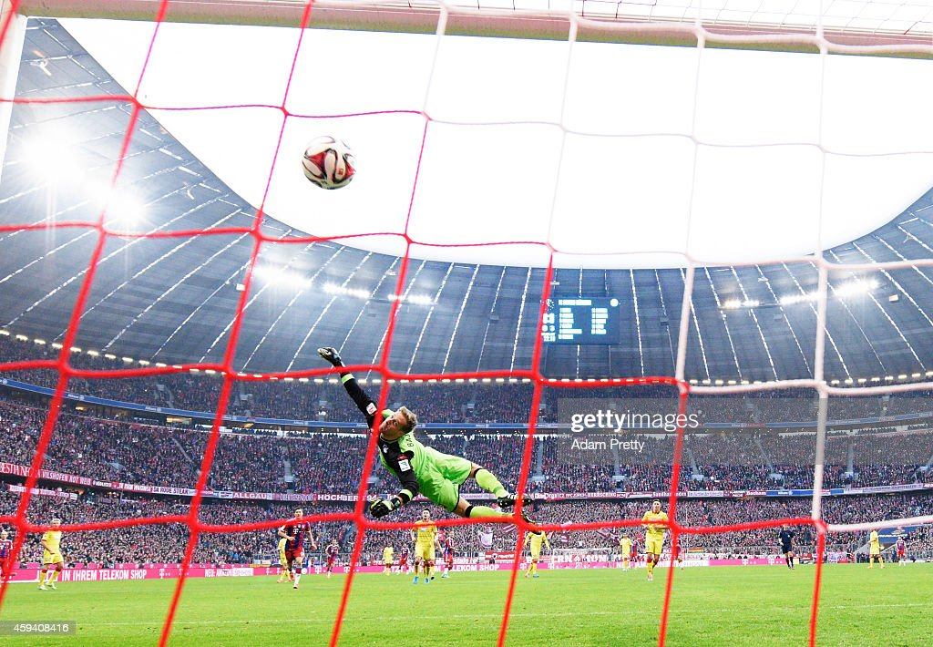 Mario Goetze of Bayern Muenchen scores the first goal past Oliver Baumann of Hoffenheim during the Bundesliga match between FC Bayern Muenchen and 1899 Hoffenheim at Allianz Arena on November 22, 2014 in Munich, Germany.