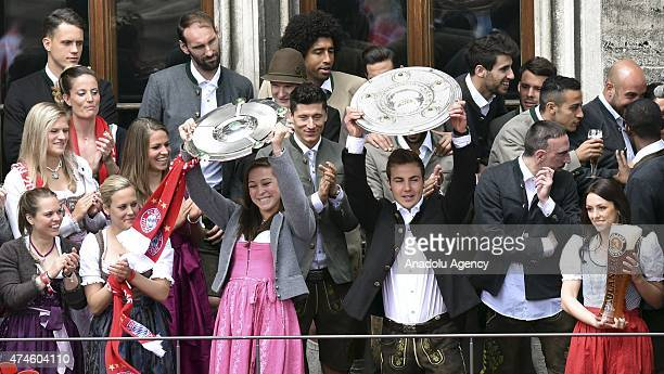 Mario Goetze of Bayern Munich holds up the championship trophy as the team celebrate the men's 25th BundesligaChampionship and the women's 2nd...