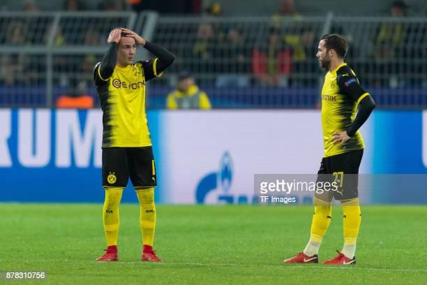 Mario Goetze of Borussia Dortmund and Gonzalo Castro of Borussia Dortmund look dejected during the UEFA Champions League group H match between...