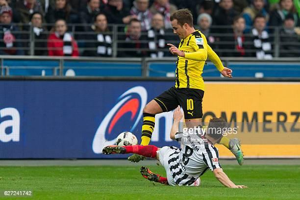 Mario Goetze of Borussia Dortmund and Szabolcs Huszti of Eintracht Frankfurt battle for the ball during the Bundesliga match between Eintracht...