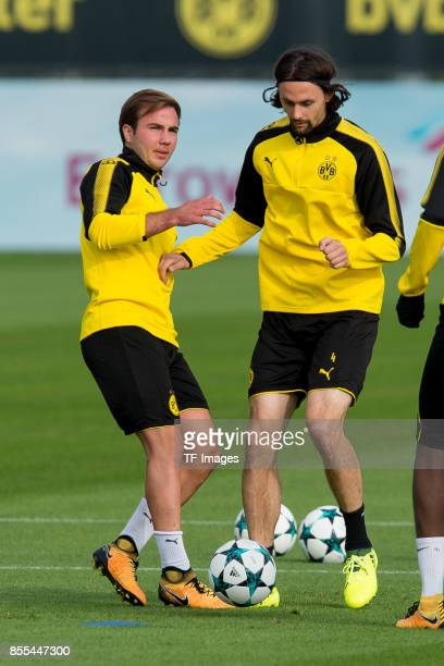 Mario Goetze of Dortmund and Neven Subotic of Dortmund battle for the ball during a Borussia Dortmund training session ahead of their UEFA Champions...
