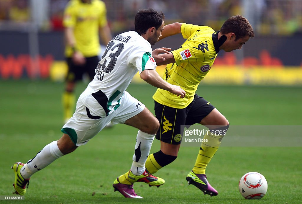 Mario Goetze of Dortmund and Sofian Chahed of Hannover battle for the ball during the Bundesliga match between Borussia Dortmund and Hannover 96 at...