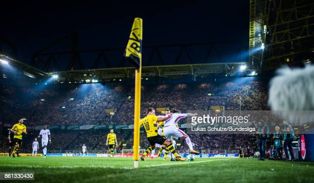 Mario Goetze of Dortmund and Yussuf Poulsen of Leipzig fight for the ball during the Bundesliga match between Borussia Dortmund and RB Leipzig at...