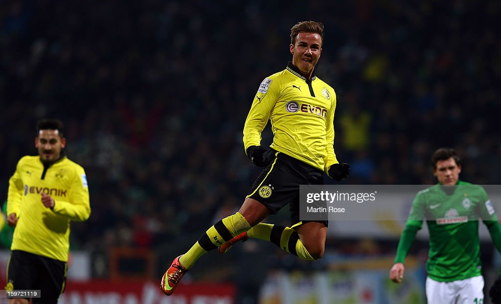 <a gi-track='captionPersonalityLinkClicked' href=/galleries/search?phrase=Mario+Goetze&family=editorial&specificpeople=4251202 ng-click='$event.stopPropagation()'>Mario Goetze</a> of Dortmund celebrates after he scores his team's 2nd goal during the Bundesliga match between Werder Bremen and Borussia Dortmund at Weser Stadium on January 19, 2013 in Bremen, Germany.