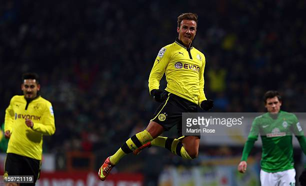 Mario Goetze of Dortmund celebrates after he scores his team's 2nd goal during the Bundesliga match between Werder Bremen and Borussia Dortmund at...
