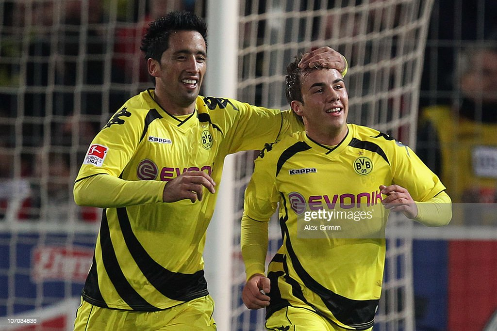 <a gi-track='captionPersonalityLinkClicked' href=/galleries/search?phrase=Mario+Goetze&family=editorial&specificpeople=4251202 ng-click='$event.stopPropagation()'>Mario Goetze</a> (R) of Dortmund celebrates his team's second goal with team mate <a gi-track='captionPersonalityLinkClicked' href=/galleries/search?phrase=Lucas+Barrios&family=editorial&specificpeople=4142497 ng-click='$event.stopPropagation()'>Lucas Barrios</a> during the Bundesliga match between SC Freiburg and Borussia Dortmund at the Badenova Stadium on November 20, 2010 in Freiburg im Breisgau, Germany.