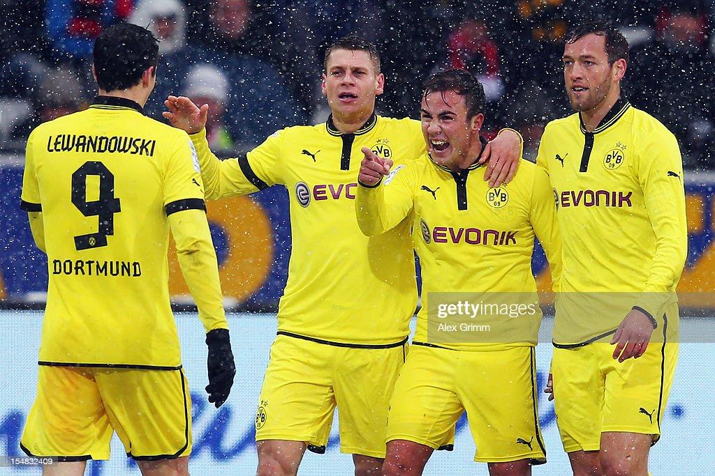 Mario Goetze of Dortmund celebrates his team's second goal with team mates Robert Lewandowski Lukasz Piszczek and Julian Schieber during the...