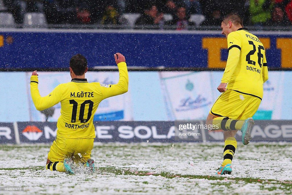 Mario Goetze of Dortmund celebrates his team's second goal with team mate Lukasz Piszczek during the Bundesliga match between SC Freiburg and...