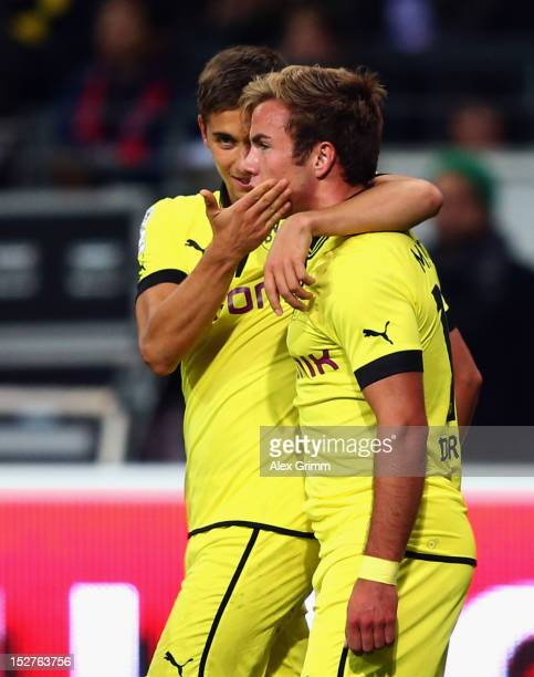 Mario Goetze of Dortmund celebrates his team's third goal with team mate Moritz Leitner during the Bundesliga match between Eintracht Frankfurt and...
