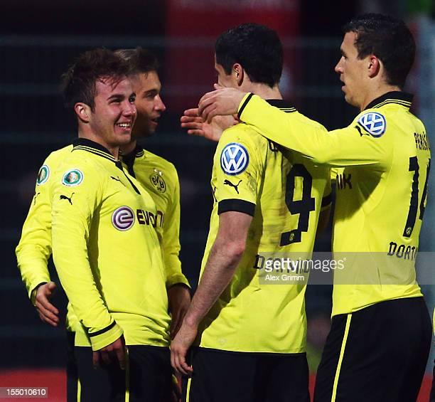 Mario Goetze of Dortmund celebrates his team's third goal with team mates Moritz Leitner Robert Lewandowski and Ivan Perisic during the second round...