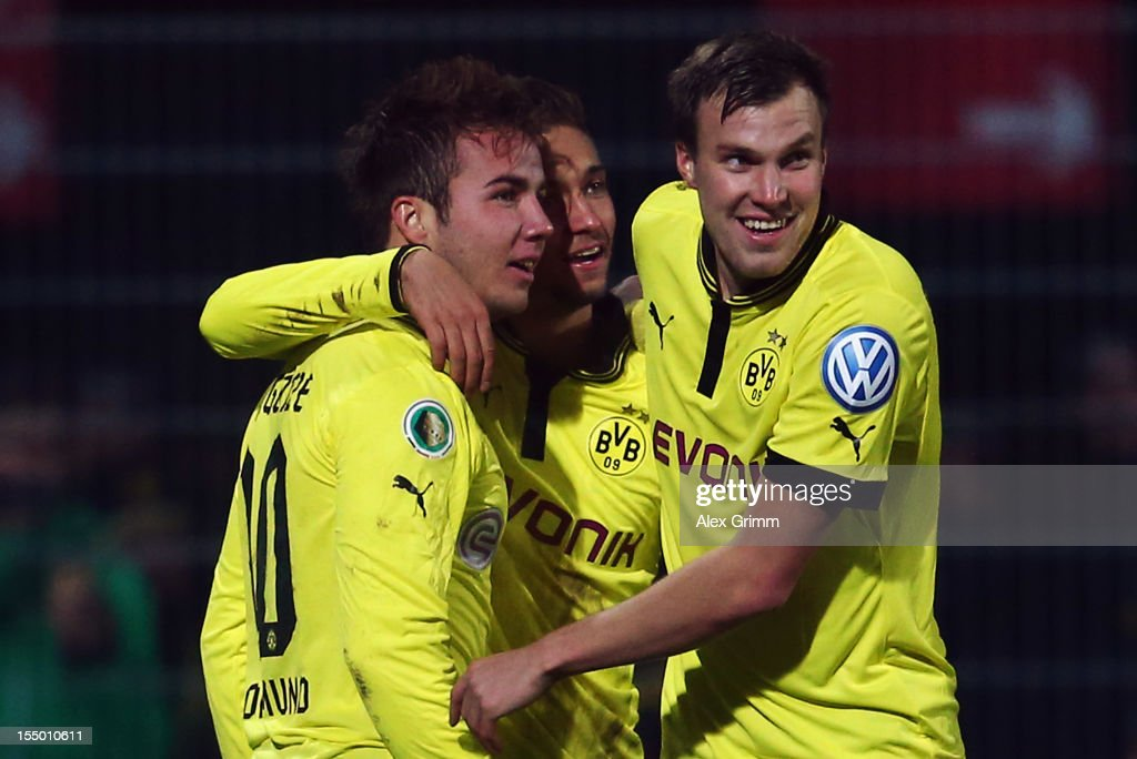 Mario Goetze of Dortmund celebrates his team's third goal with team mates Moritz Leitner and Kevin Grosskreutz during the second round match of the...