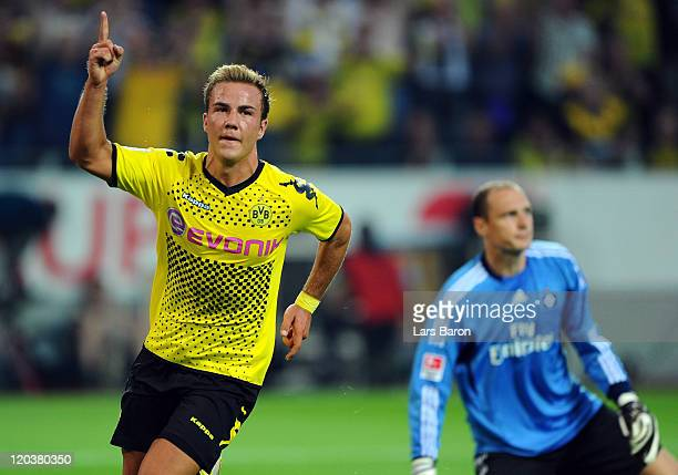 Mario Goetze of Dortmund celebrates next to goalkeeper Jaroslav Drobny of Hamburg after scoring his teams second goal during the Bundesliga match...