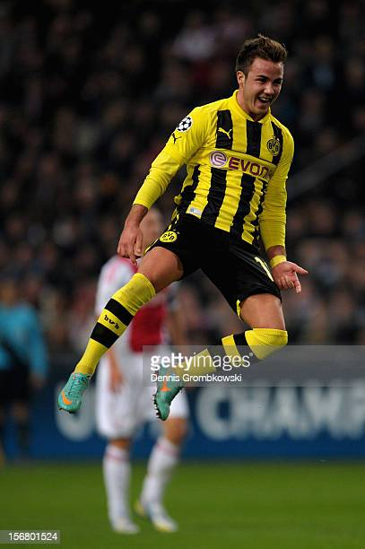 Mario Goetze of Dortmund celebrates scoring his team's second goal during the UEFA Champions League Group D match between Ajax Amsterdam and Borussia...