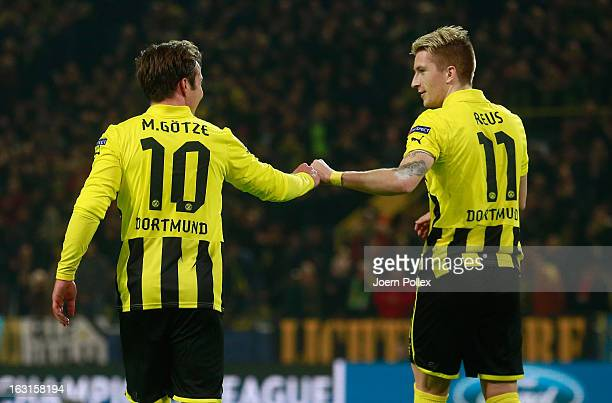 Mario Goetze of Dortmund celebrates with his team mate Marco Reus after scoring his team's second goal during the UEFA Champions League round of 16...