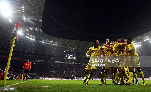 Mario Goetze of Dortmund celebrates with Kevin Grosskreutz and other team mates after scoring his teams third goal during the Bundesliga match...