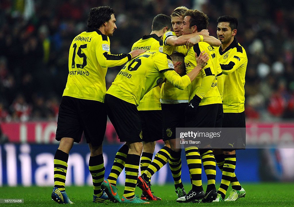 <a gi-track='captionPersonalityLinkClicked' href=/galleries/search?phrase=Mario+Goetze&family=editorial&specificpeople=4251202 ng-click='$event.stopPropagation()'>Mario Goetze</a> of Dortmund celebrates with <a gi-track='captionPersonalityLinkClicked' href=/galleries/search?phrase=Marco+Reus&family=editorial&specificpeople=5445884 ng-click='$event.stopPropagation()'>Marco Reus</a> and other team mates after scoring his teams first goal during the Bundesliga match between Bayern Muenchen and Borussia Dortmund at Allianz Arena on December 1, 2012 in Munich, Germany.