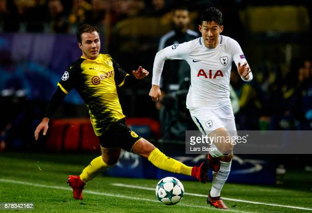 Mario Goetze of Dortmund challengen Heung Min Son of Tottenham during the UEFA Champions League group H match between Borussia Dortmund and Tottenham...