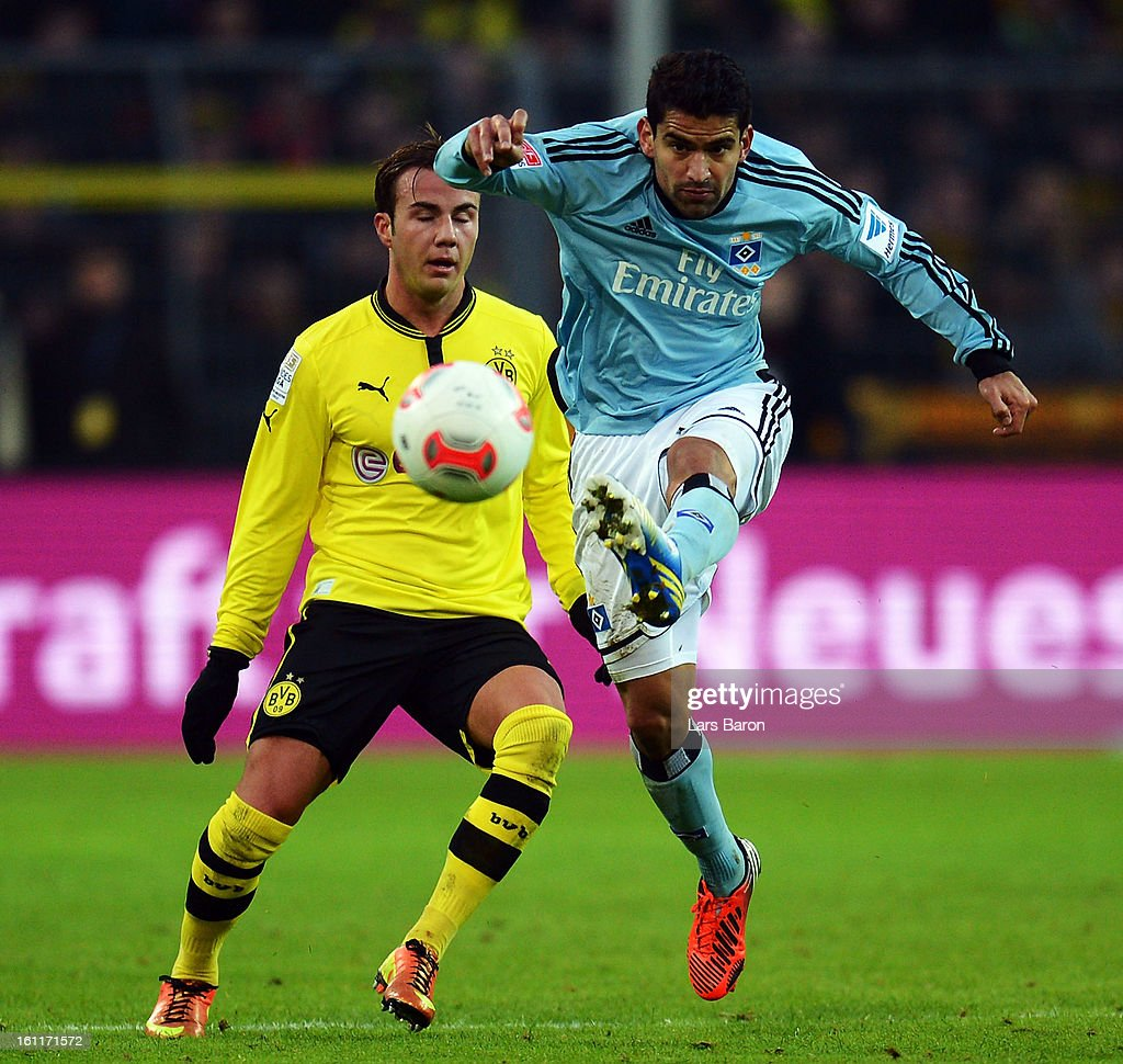 <a gi-track='captionPersonalityLinkClicked' href=/galleries/search?phrase=Mario+Goetze&family=editorial&specificpeople=4251202 ng-click='$event.stopPropagation()'>Mario Goetze</a> of Dortmund challenges Rincon of Hamburg during the Bundesliga match between Borussia Dortmund and Hamburger SV at Signal Iduna Park on February 9, 2013 in Dortmund, Germany.