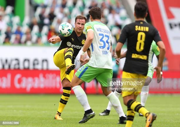 Mario Goetze of Dortmund competes with Mario Gomez of Wolfsburg during the Bundesliga match between VfL Wolfsburg and Borussia Dortmund at Volkswagen...