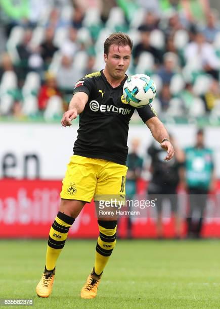 Mario Goetze of Dortmund controls the ball during the Bundesliga match between VfL Wolfsburg and Borussia Dortmund at Volkswagen Arena on August 19...