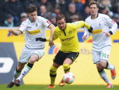 Mario Goetze of Dortmund is challenged by Havard Nordtveit and Thorben Marx of Moenchengladbach during the Bundesliga match between VfL Borussia...