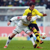 Mario Goetze of Dortmund is challenged by Thorben Marx of Moenchengladbach during the Bundesliga match between VfL Borussia Moenchengladbach and...