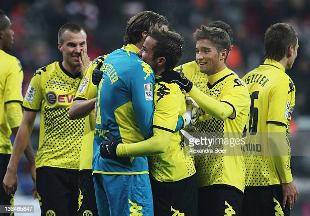 Mario Goetze of Dortmund is hugged by his goalkeeper Roman Weidenfeller after their teams' victory of the Bundesliga match between FC Bayern Muenchen...
