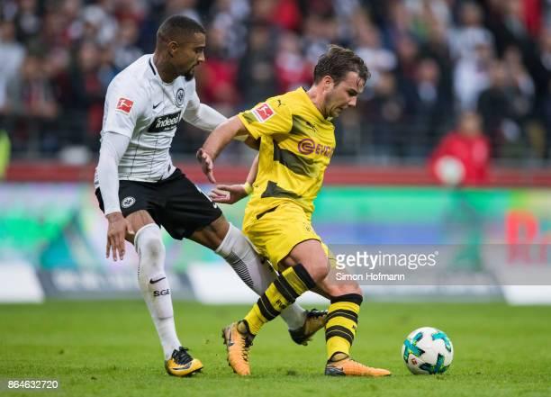 Mario Goetze of Dortmund is tackled by KevinPrince Boateng of Frankfurt during the Bundesliga match between Eintracht Frankfurt and Borussia Dortmund...