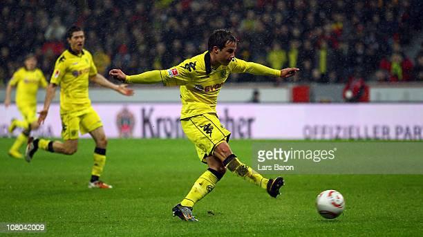 Mario Goetze of Dortmund score his teams third goal during the Bundesliga match between Bayer Leverkusen and Borussia Dortmund at BayArena on January...