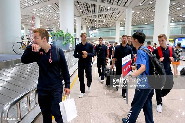 Mario Goetze of FC Bayern Muenchen arrives with Thomas Mueller Robert Lewandowski Xabi Alonso Josuha Kimmich and the team at Beijing Capital Airport...