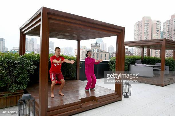 Mario Goetze of FC Bayern Muenchen performes Chinese kungfu with Chinese martial Artist Cecilia on the roof top of the 'Twelve at Hengshan' team...