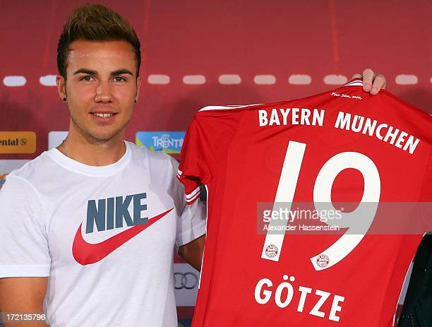 Mario Goetze of FC Bayern Muenchen presents his new match jersey after a press conference at Bayern Muenchens headquarter Saebener Strasse on July 2...