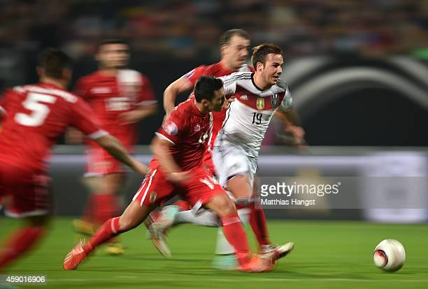 Mario Goetze of Germany breaks past the Gibraltar defence during the EURO 2016 Group D Qualifier match between Germany and Gibraltar at Grundig...