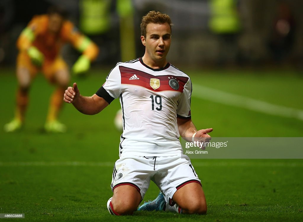 <a gi-track='captionPersonalityLinkClicked' href=/galleries/search?phrase=Mario+Goetze&family=editorial&specificpeople=4251202 ng-click='$event.stopPropagation()'>Mario Goetze</a> of Germany celebrates after scoring his teams third goal during the EURO 2016 Qualifier Group D match between Germany and Poland at Commerzbank-Arena on September 4, 2015 in Frankfurt am Main, Germany.