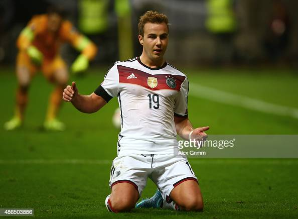 Mario Goetze of Germany celebrates after scoring his teams third goal during the EURO 2016 Qualifier Group D match between Germany and Poland at...