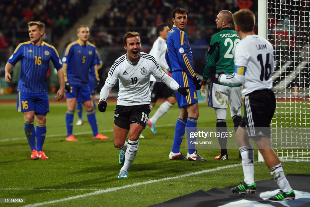 Mario Goetze (C) of Germany celebrates his team's second goal with team mate <a gi-track='captionPersonalityLinkClicked' href=/galleries/search?phrase=Philipp+Lahm&family=editorial&specificpeople=483746 ng-click='$event.stopPropagation()'>Philipp Lahm</a> during the FIFA 2014 World Cup qualifier between Germany and Kazakhstan at Grundig-Stadion on March 26, 2013 in Nuremberg, Germany.
