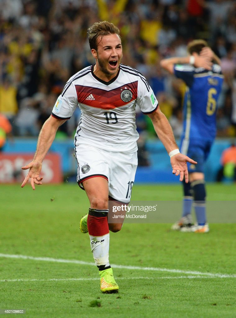 <a gi-track='captionPersonalityLinkClicked' href=/galleries/search?phrase=Mario+Goetze&family=editorial&specificpeople=4251202 ng-click='$event.stopPropagation()'>Mario Goetze</a> of Germany celebrates scoring his team's first goal in extra time during the 2014 FIFA World Cup Brazil Final match between Germany and Argentina at Maracana on July 13, 2014 in Rio de Janeiro, Brazil.