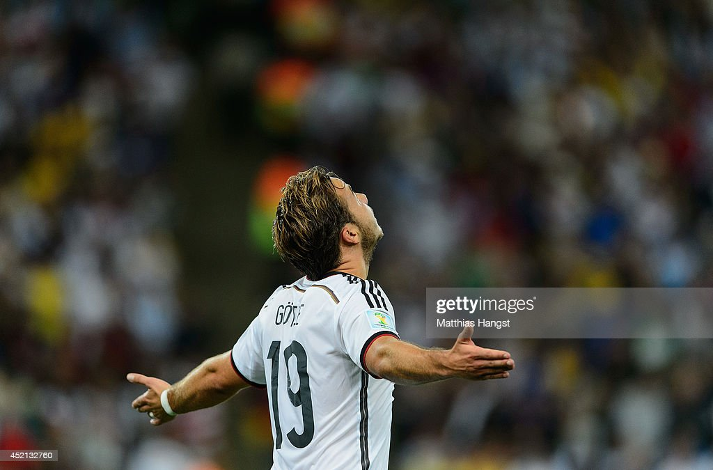 <a gi-track='captionPersonalityLinkClicked' href=/galleries/search?phrase=Mario+Goetze&family=editorial&specificpeople=4251202 ng-click='$event.stopPropagation()'>Mario Goetze</a> of Germany celebrates scoring his team's first goal during the 2014 FIFA World Cup Brazil Final match between Germany and Argentina at Maracana on July 13, 2014 in Rio de Janeiro, Brazil.