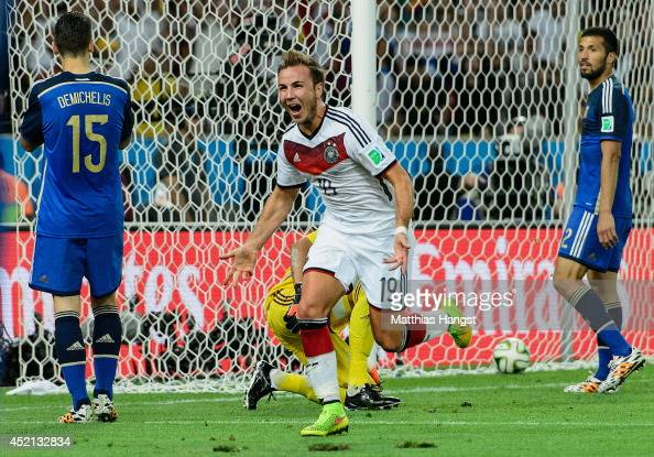 Mario Goetze of Germany celebrates scoring his team's first goal during the 2014 FIFA World Cup Brazil Final match between Germany and Argentina at...