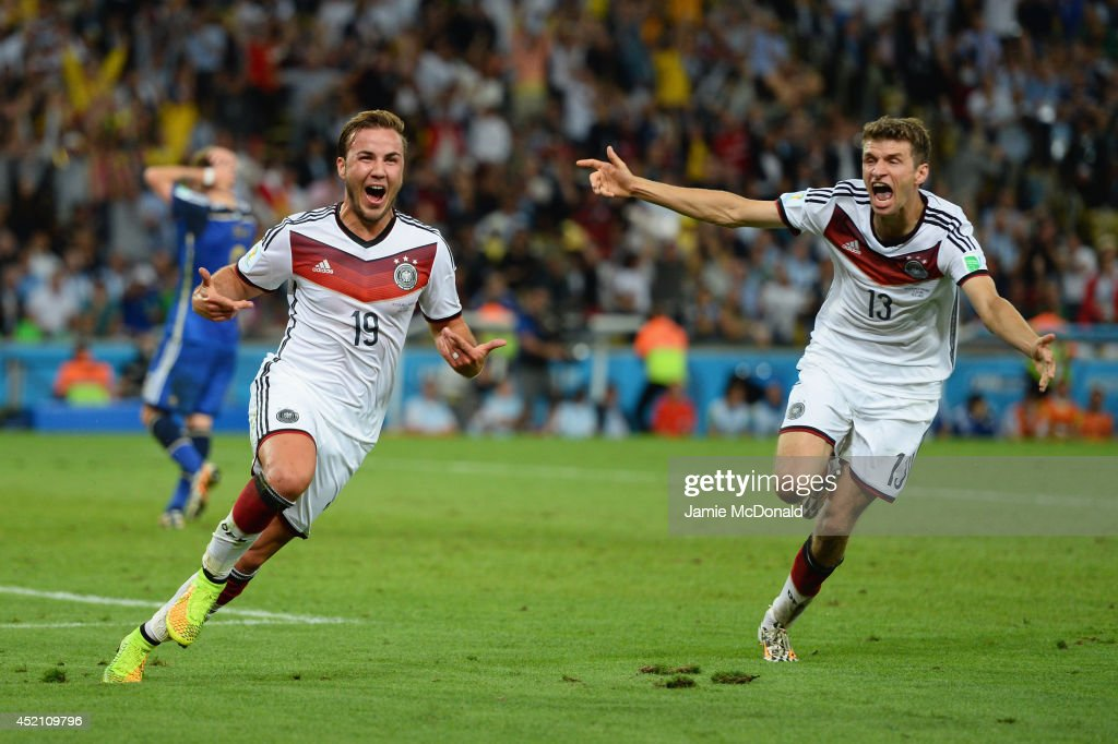 <a gi-track='captionPersonalityLinkClicked' href=/galleries/search?phrase=Mario+Goetze&family=editorial&specificpeople=4251202 ng-click='$event.stopPropagation()'>Mario Goetze</a> of Germany (L) celebrates scoring his team's first goal with <a gi-track='captionPersonalityLinkClicked' href=/galleries/search?phrase=Thomas+Mueller&family=editorial&specificpeople=5842906 ng-click='$event.stopPropagation()'>Thomas Mueller</a> during the 2014 FIFA World Cup Brazil Final match between Germany and Argentina at Maracana on July 13, 2014 in Rio de Janeiro, Brazil.