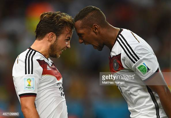 Mario Goetze of Germany celebrates scoring his team's first goal with Jerome Boateng during the 2014 FIFA World Cup Brazil Final match between...
