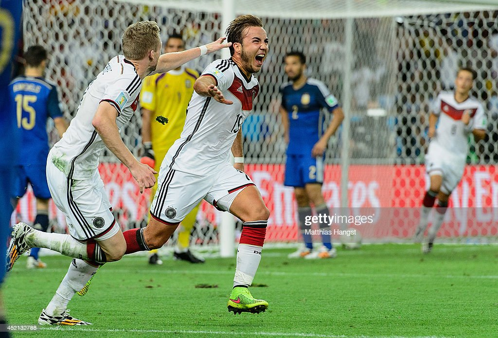 Mario Goetze of Germany celebrates scoring his team's first goal with Andre Schuerrle during the 2014 FIFA World Cup Brazil Final match between...